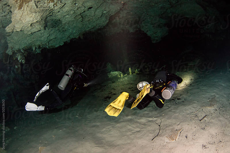 Two scuba divers swimming in Mexico's  Cenote  Dos Ojos by Song Heming for Stocksy United