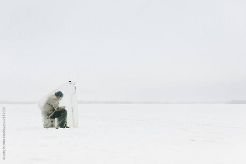 Winter fishing by Alexey Kuzma for Stocksy United