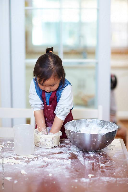 little asian girls having fun in kitchen by cuiyan Liu for Stocksy United