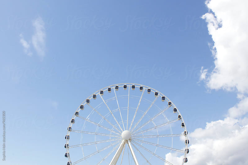Ferris wheel and blue sky by Sophia Hsin for Stocksy United