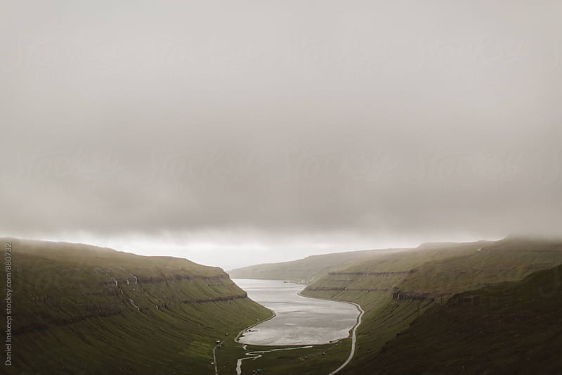 A Cloudy Inlet in the Faroe Islands by Daniel Inskeep for Stocksy United