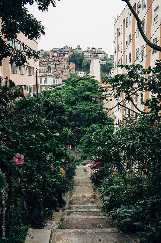 Narrow street with lots of greenery by Gabriel Tichy for Stocksy United