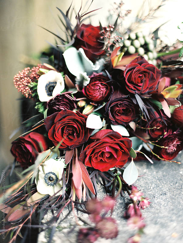 bridal burgundy bouquet by Kirill Bordon photography for Stocksy United