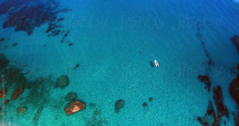 Aerial view of a boat in the mediterranean sea, Sardinia by Luca Pierro for Stocksy United