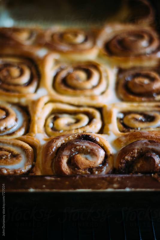 Fresh homemade cinnamon roll by John Dunaway for Stocksy United