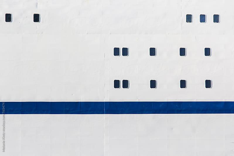 Windows of a ferry  by Melanie Kintz for Stocksy United