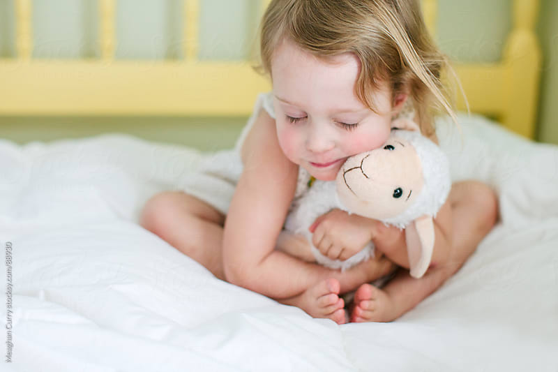 little girl hugging her stuffed animal by Meaghan Curry for Stocksy United