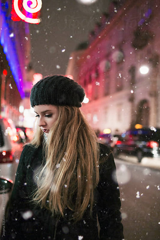 Young woman and snow by Jovana Rikalo for Stocksy United