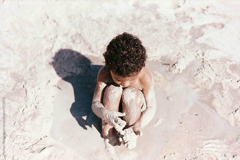 Toddler At The Beach by Marlon Richardson for Stocksy United