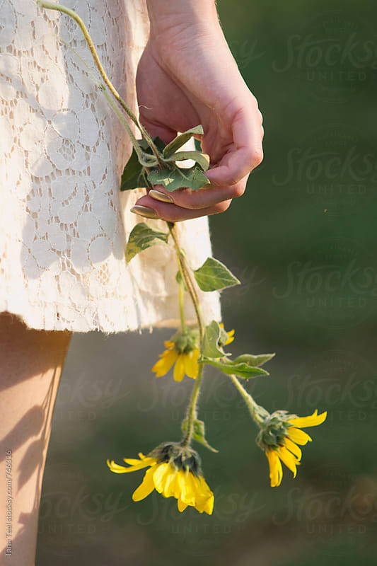 woman holds wildflowers  by Tana Teel for Stocksy United