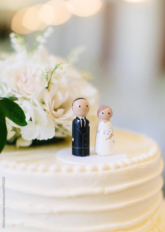 White wedding cake by Marta Locklear for Stocksy United