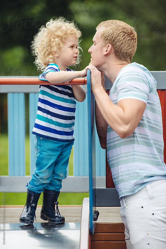 father and son at the playground by Andreas Gradin for Stocksy United