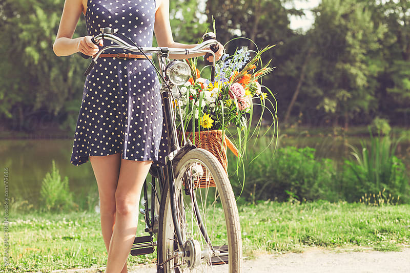 Woman With Old-Fashioned Bicycle and Flowers by VISUALSPECTRUM for Stocksy United