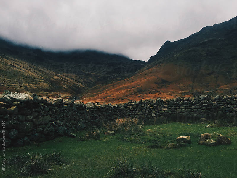 Stone walls and hills by Neil Warburton for Stocksy United