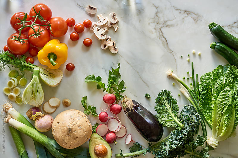Assortment of organic healthy vegetables on table for wellness by Trent Lanz for Stocksy United