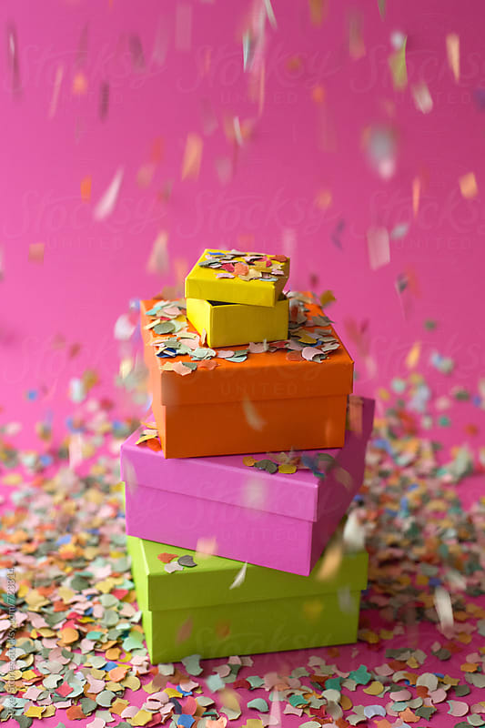 Colorful presents with falling confetti  by Pixel Stories for Stocksy United