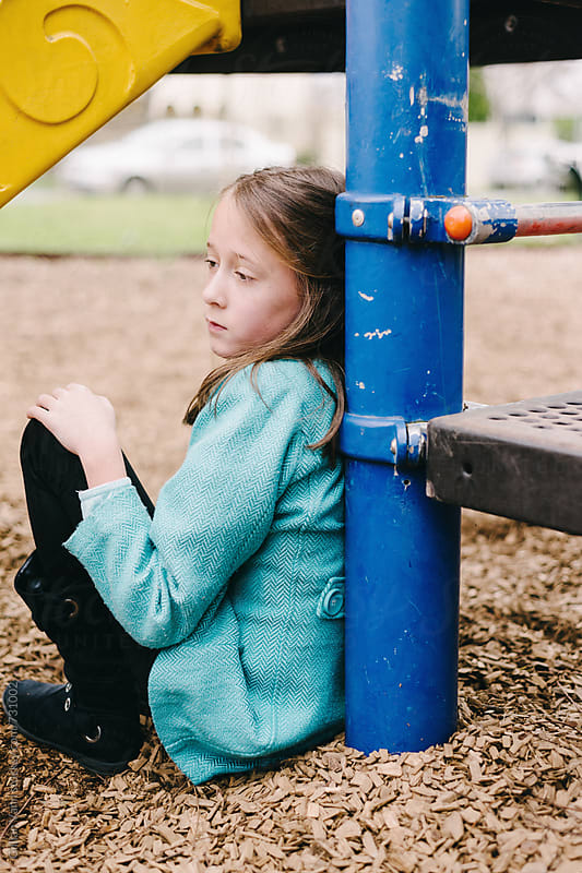 sad girl in the playground by Gillian Vann for Stocksy United