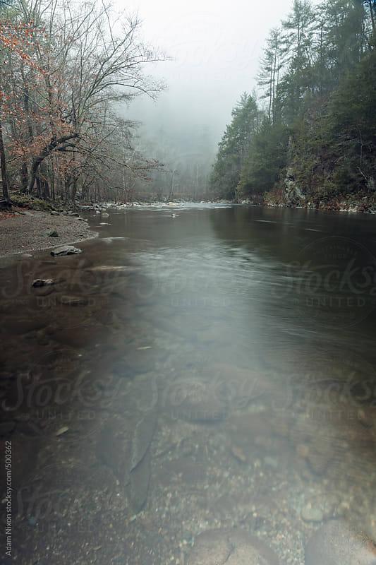 Foggy mountain river by Adam Nixon for Stocksy United