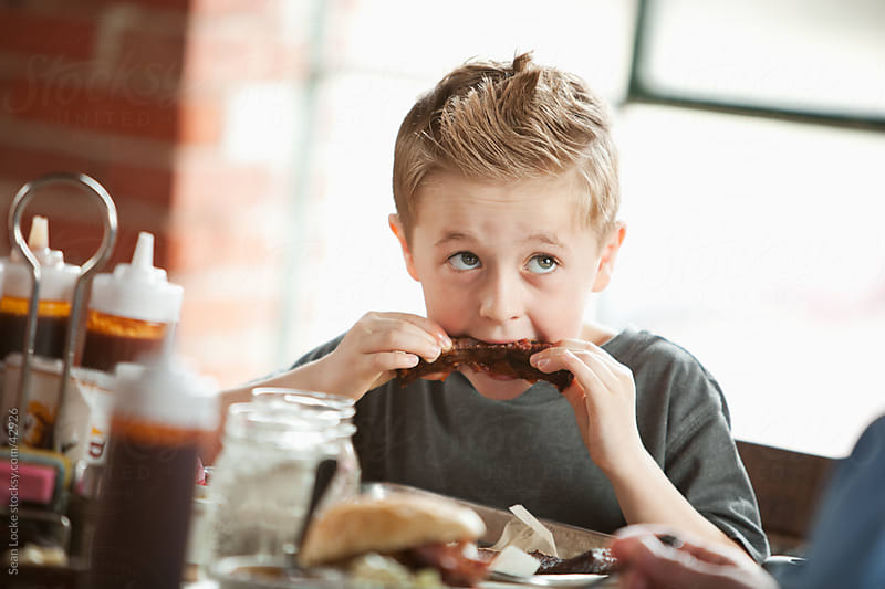 Barbeque: Little Boy Gets Into Eating Ribs by Sean Locke for Stocksy United