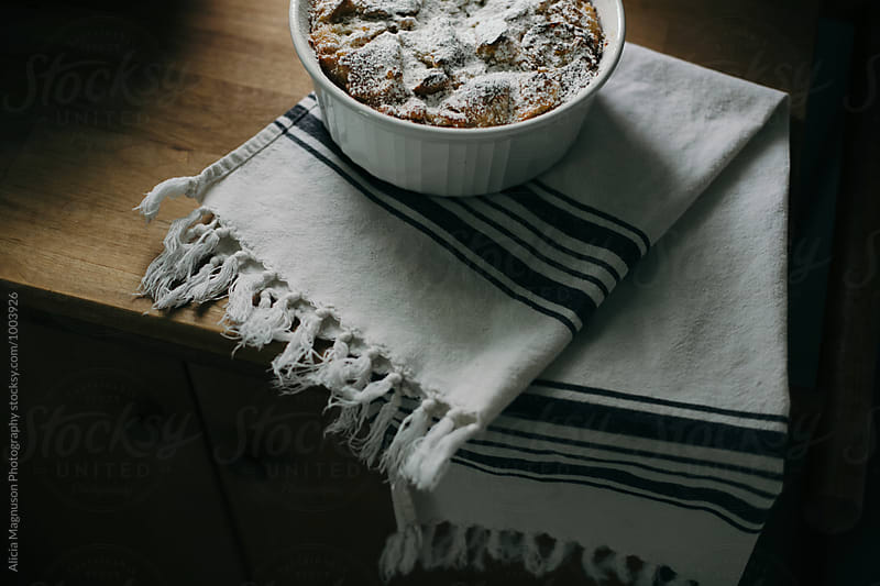 Bread Pudding Cooling on Counter by Alicia Magnuson Photography for Stocksy United