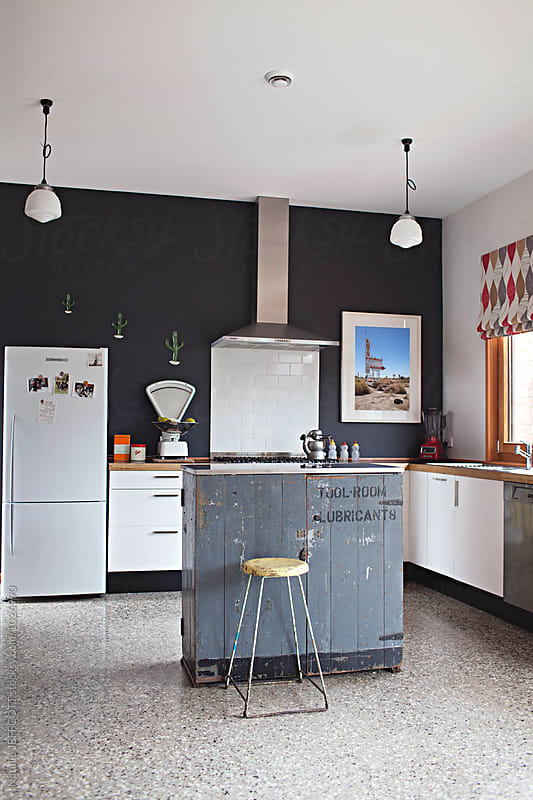 Modern Interior design with vintage details in kitchen by Natalie JEFFCOTT for Stocksy United