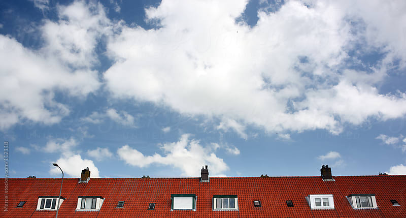 Red roofs of Dutch housing by Marcel for Stocksy United