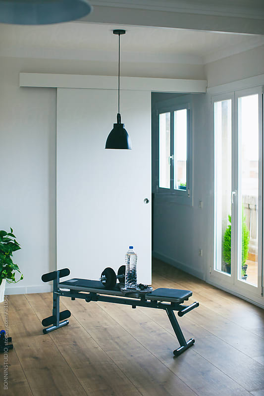 Workout bench at home. by BONNINSTUDIO for Stocksy United