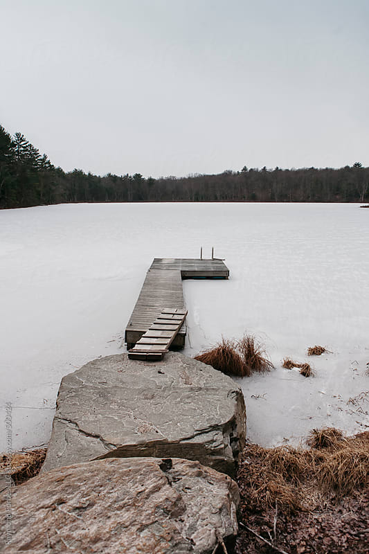 Dock on Frozen Lake by Raymond Forbes LLC for Stocksy United