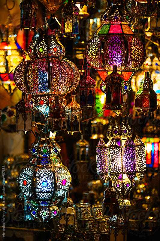 Colourful traditional lamps in market at night by Alejandro Moreno de Carlos for Stocksy United
