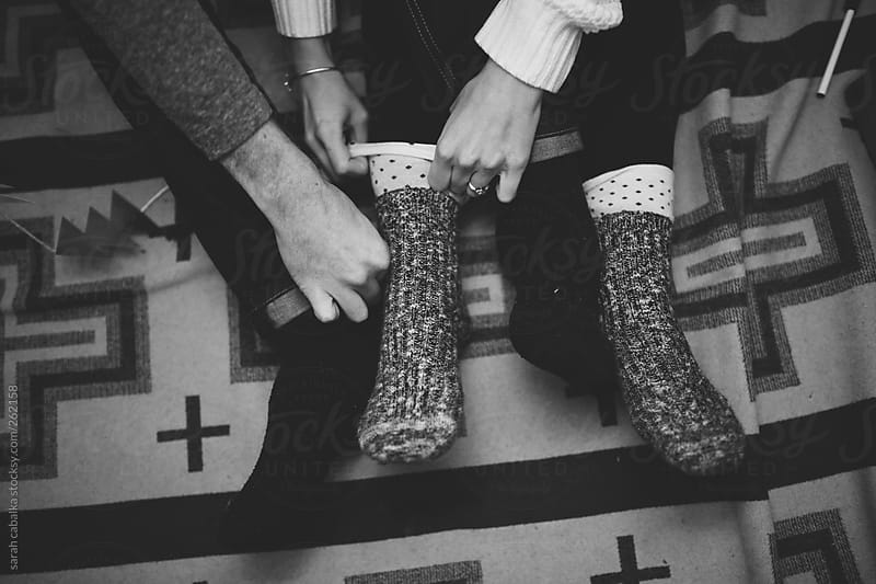 Couple's feet by sarah cabalka for Stocksy United