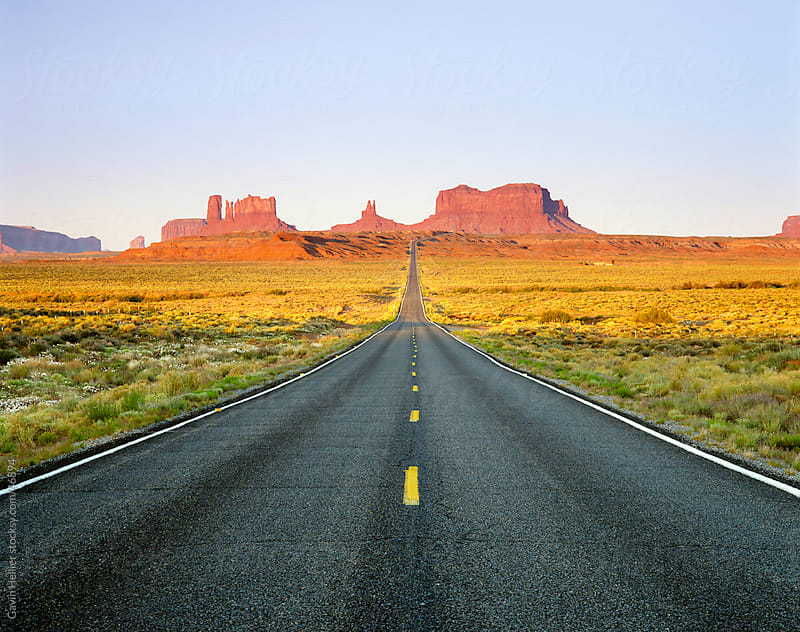 Empty Road, Highway 163, Monument Valley, Utah, United States of America, North America  by Gavin Hellier for Stocksy United