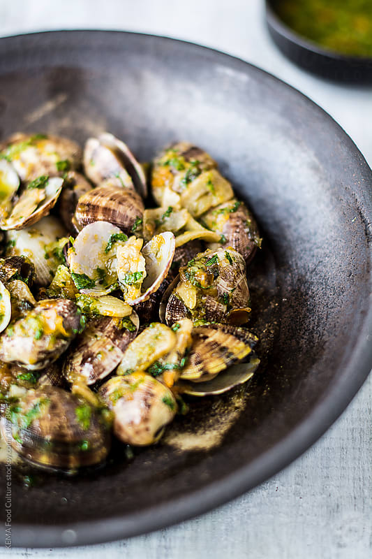 Clams with spicy seafood dip  by KEMA Food Culture for Stocksy United