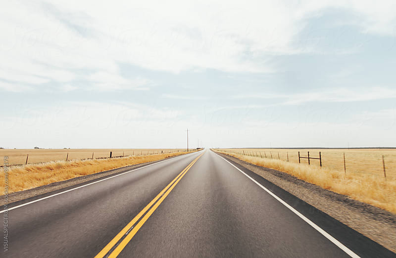 Empty Road in Dry Grassland by VISUALSPECTRUM for Stocksy United