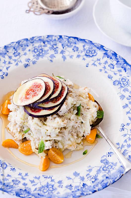 Healthy breakfast bircher muesli with fresh fruit by Jill Chen for Stocksy United