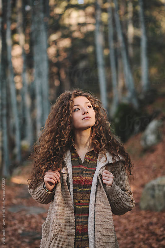 Portrait of a beautiful young woman in the forest by Aleksandar Novoselski for Stocksy United