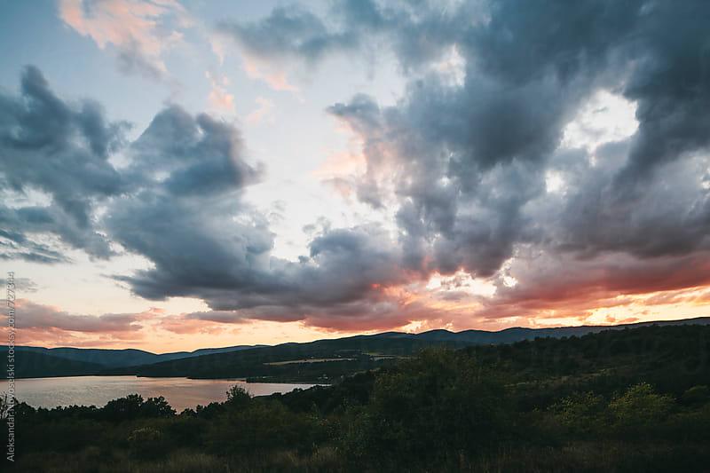 Beautiful landscape of a lake in the mountain, by sunset by Aleksandar Novoselski for Stocksy United