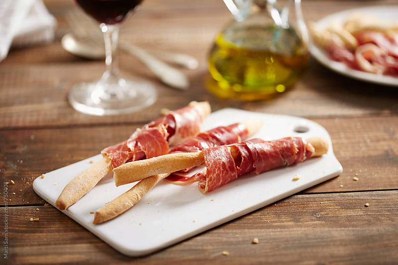 Bread sticks with ham by Martí Sans for Stocksy United