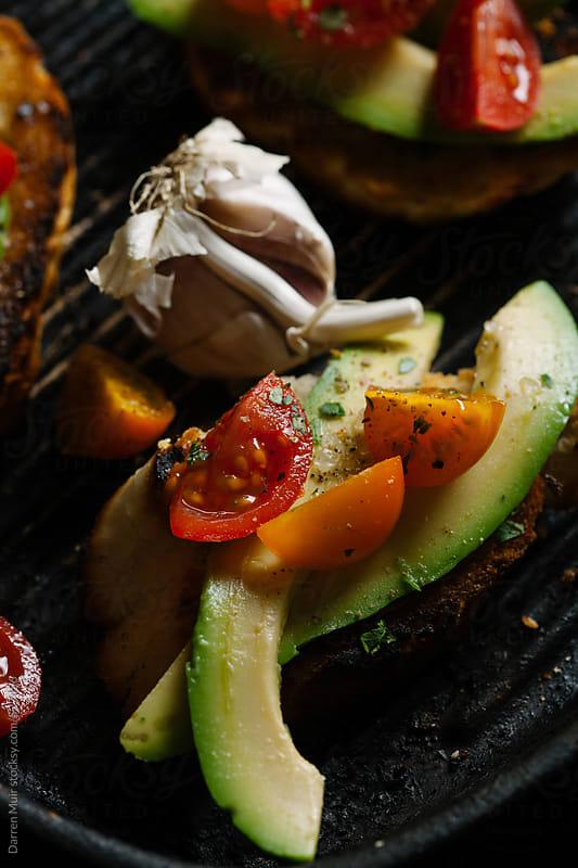 Avocado and tomato crostini. by Darren Muir for Stocksy United