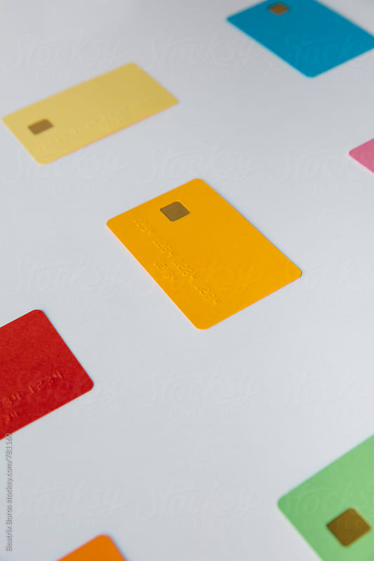 Colorful black credit cards on white by Beatrix Boros for Stocksy United