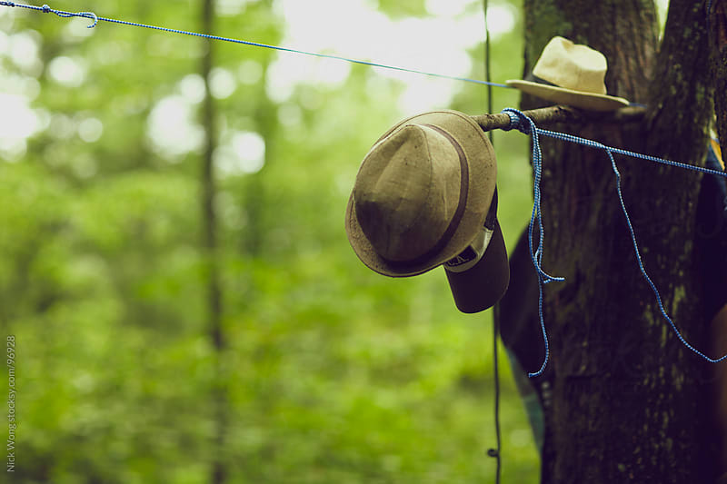 hats hanging outdoors in campsite by Nick Wong for Stocksy United