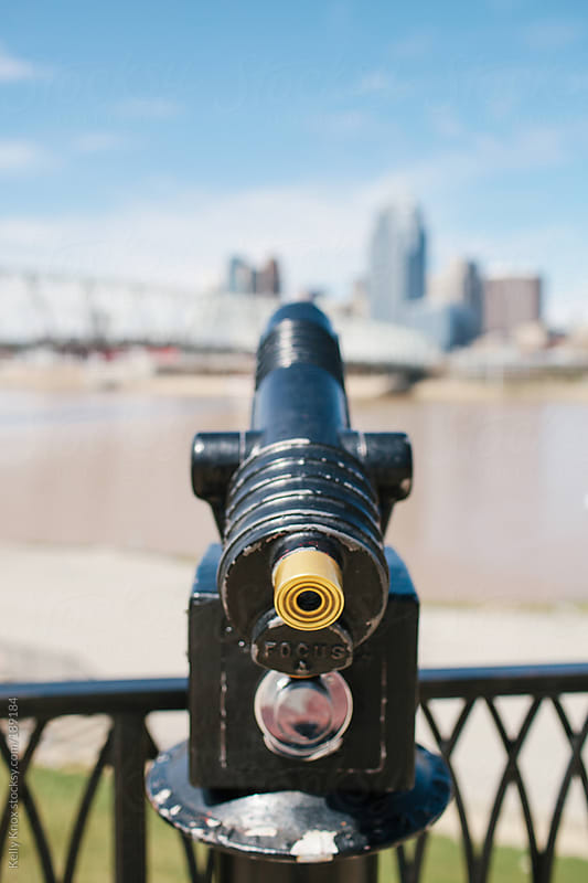 coin operated telescope facing a city skyline by Kelly Knox for Stocksy United