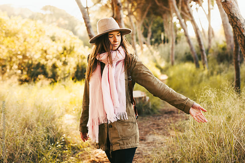 Hipster woman enjoying the forest in autumn. by BONNINSTUDIO for Stocksy United