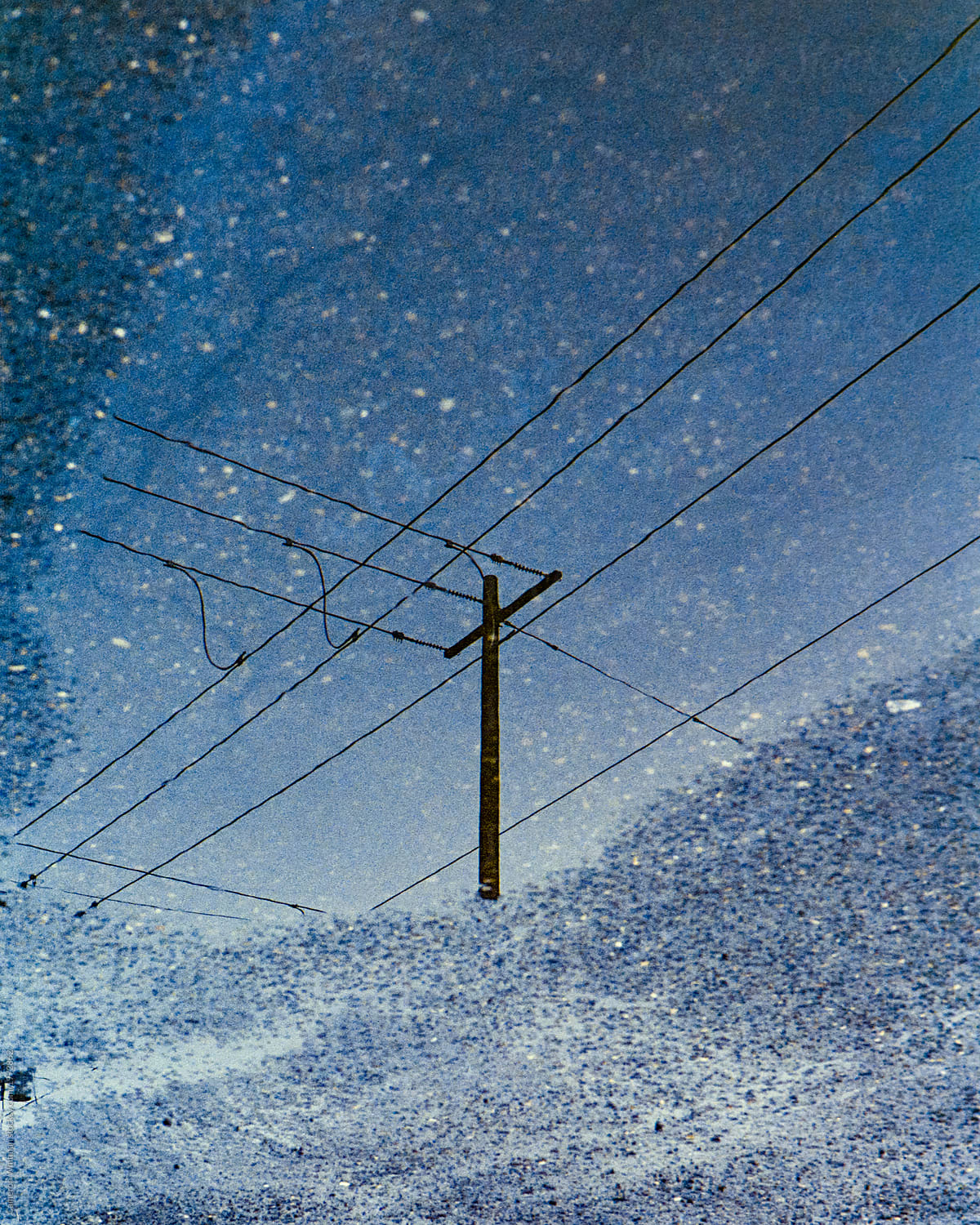Telephone Wires Crossing In A Puddle Reflection Stocksy United Wiring Cable By Cameron Whitman For