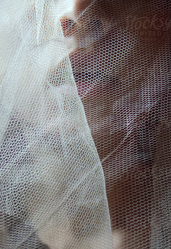sensual lips behind a veil closeup by Sonja Lekovic for Stocksy United