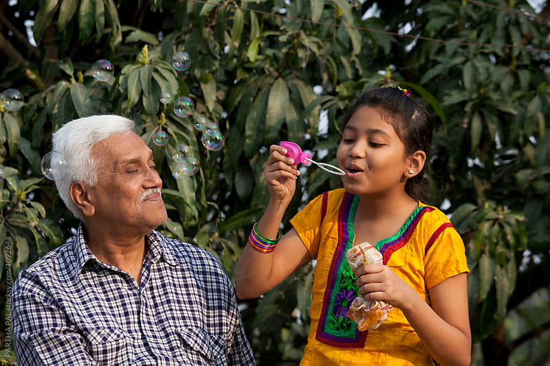 Grandfather and grandchildren making fun at outdoor by PARTHA PAL for Stocksy United