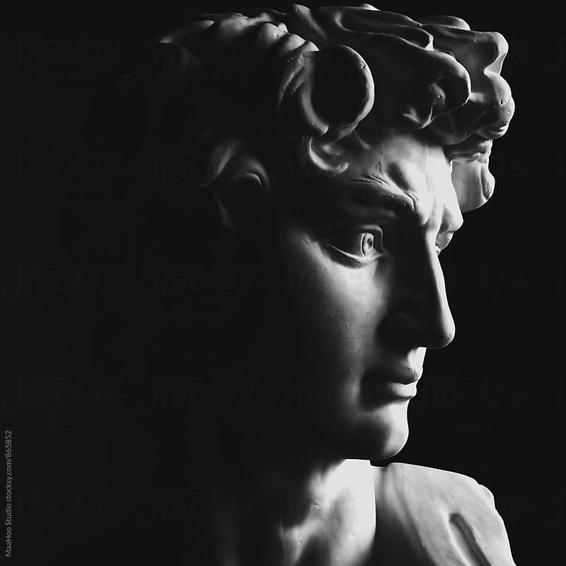 Close up of a classical sculpture of a man by Maa Hoo for Stocksy United