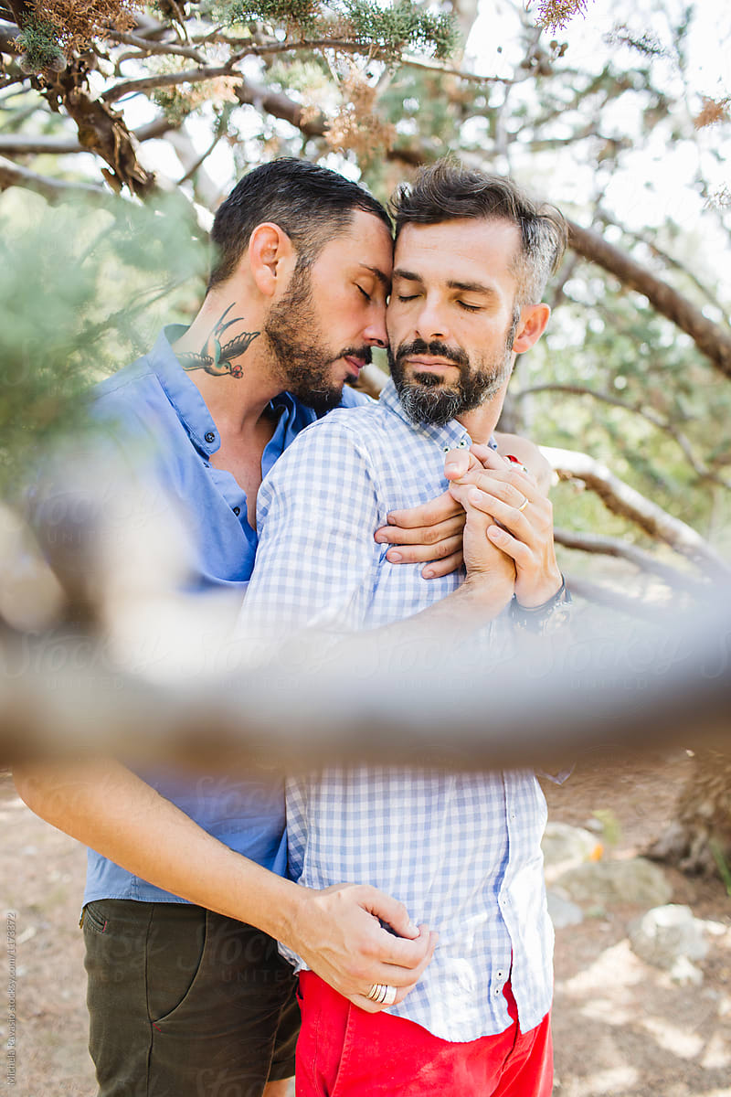 Passionate embrace between two men in love by michela