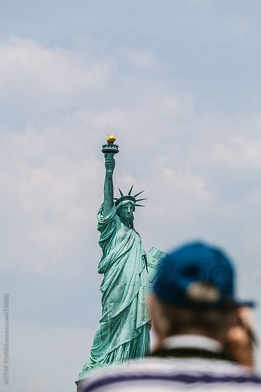 Tourist Taking a Photo to the Liberty Statue in New York by VICTOR TORRES for Stocksy United