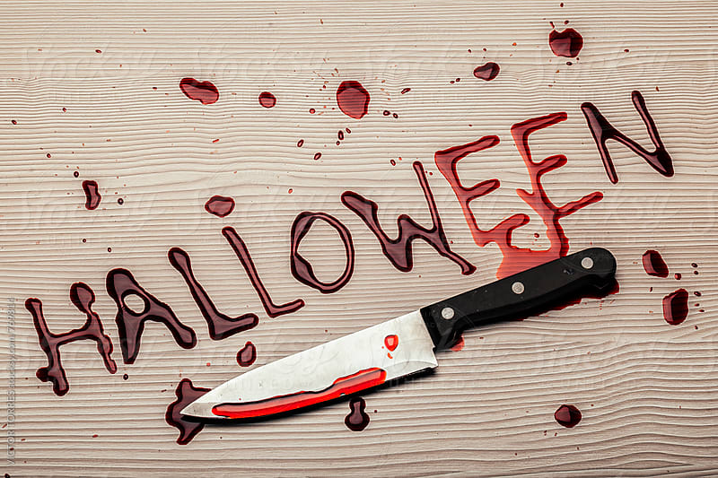 Bloody Halloween Lettering with a Big Knife by Victor Torres for Stocksy United