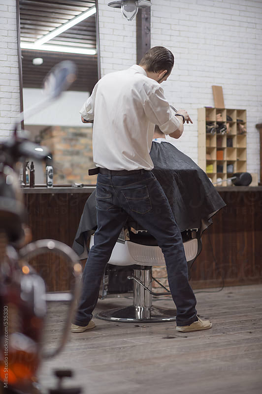 Barber with client in barbershop by Milles Studio for Stocksy United
